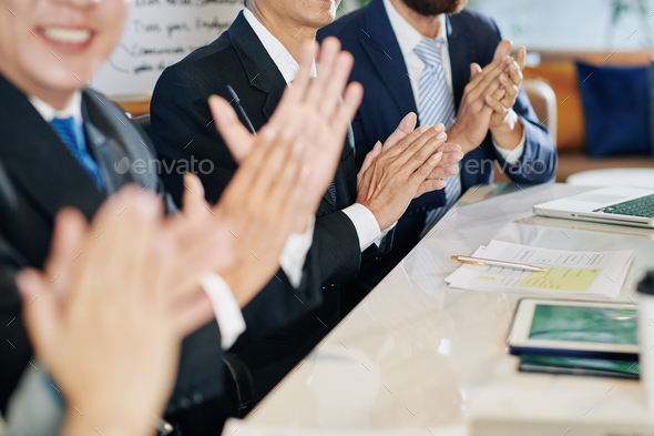Clapping business people - Stock Photo - Images