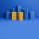 Miniature city with blue yellow paper houses on blue background. - PhotoDune Item for Sale