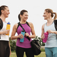 Three healthy fit young women standing chatting - PhotoDune Item for Sale