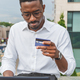 Businessman using credit card and laptop at home office - PhotoDune Item for Sale