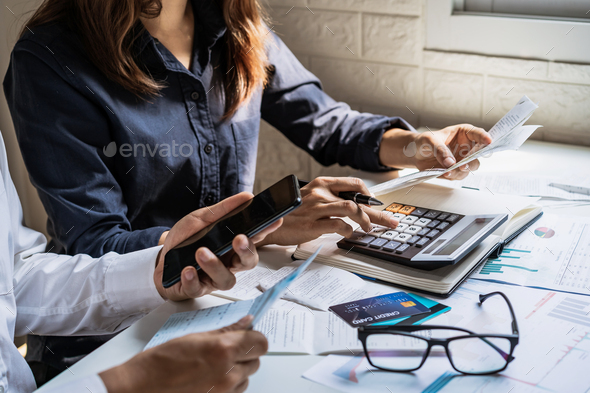 Stressed young couple checking bills and calculating expenses in the living room at home - Stock Photo - Images