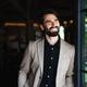 Portrait of businessman with jacket standing indoors in restaurant - PhotoDune Item for Sale