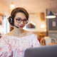 Young woman with headset and laptop indoors in cafe, working - PhotoDune Item for Sale