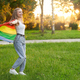 Laughing tolerant woman dancing with rainbow lgbt flag - PhotoDune Item for Sale