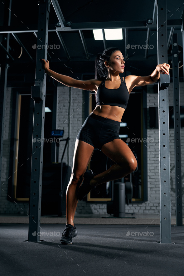 Fitnesswoman posing in gym - Stock Photo - Images