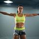 Female bodybuilder training with dumbbells - PhotoDune Item for Sale