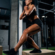 Sportswoman squatting on box in gym - PhotoDune Item for Sale