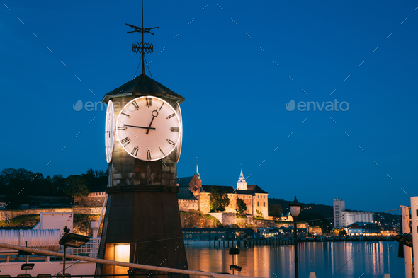 Oslo. Norway. Old Clock at Aker Brygge In Oslo Embankment, Norway. Night View Of Famous And Popular - Stock Photo - Images