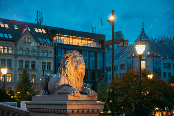 Oslo, Norway. Night View Of Lion Statue Near Storting Building. Parliament Of Norway Building - Stock Photo - Images