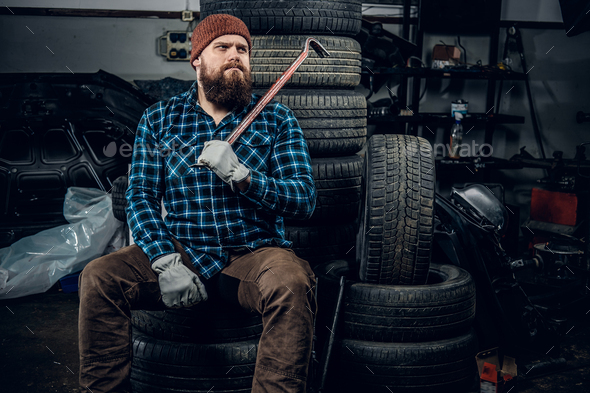 A man in a garage - Stock Photo - Images
