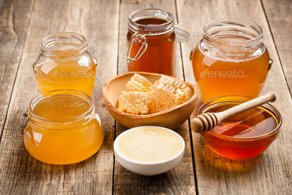 Various honey on wooden table - Stock Photo - Images