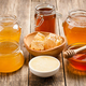 Various honey on wooden table - PhotoDune Item for Sale