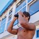 Shirtless muscular rescue looking through binocular. - PhotoDune Item for Sale