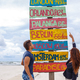 One guy and redhead girl possing over directions signpost. - PhotoDune Item for Sale
