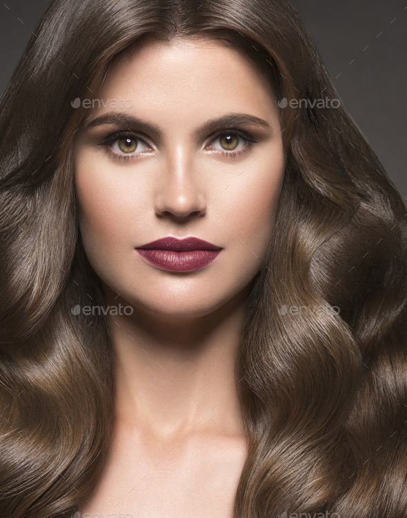 Beauty hair woman portrait long curly hairstyle fashion makeup healthy skin. Dark background. - Stock Photo - Images