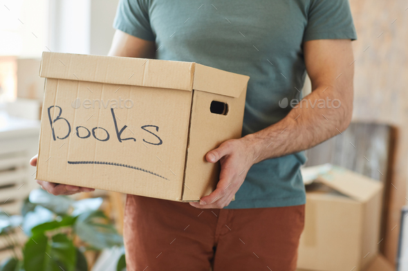 Packing books in box - Stock Photo - Images