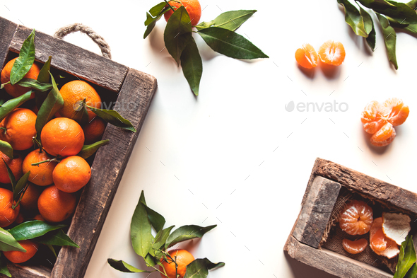 tangerines with fresh leaves in wooden box isolated on white, isolated on a white, top view - Stock Photo - Images