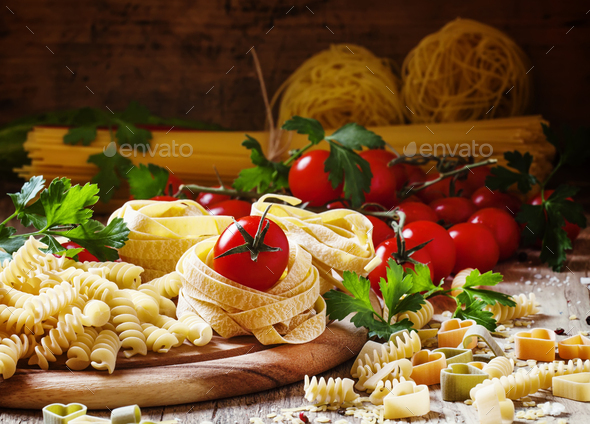 Assorted dry pasta, cherry tomatoes and parsley - Stock Photo - Images