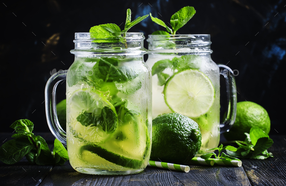 Iced green tea with lime and mint in glass jars - Stock Photo - Images