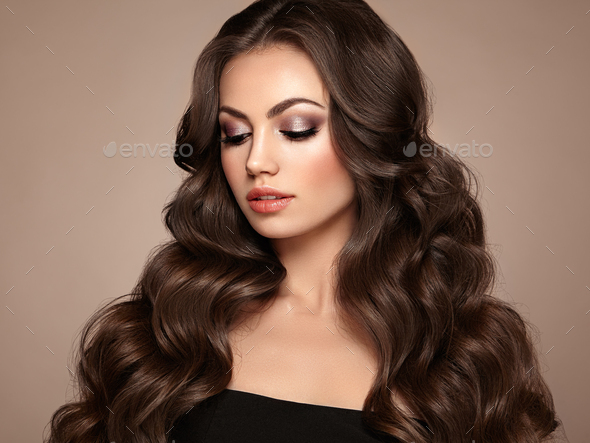 Brunette woman with curly hair - Stock Photo - Images