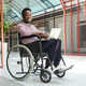 Disabled man working on laptop - PhotoDune Item for Sale