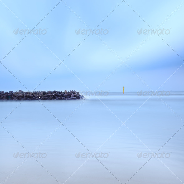 Tetrapods breakwater concrete structure protection seascape long exposure photography - Stock Photo - Images