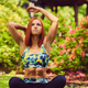 Sporty redhead female relaxing in outdoor summer park. - PhotoDune Item for Sale