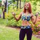 Portrait of redhead fitness female holds dumbbells. - PhotoDune Item for Sale