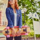 The attractive redhead female holds Longboard. - PhotoDune Item for Sale