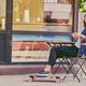 Redhead girl drinks coffee after skating on Longboard. - PhotoDune Item for Sale