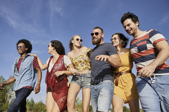 Young people in a row on the fresh air - Stock Photo - Images