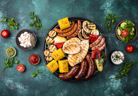 Grilled sausages, meat, and vegetables - Stock Photo - Images