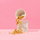 cornflakes fall out of a white bowl - PhotoDune Item for Sale