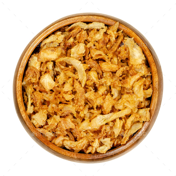French fried onions, crisp deep fried slices of onions in wooden bowl - Stock Photo - Images