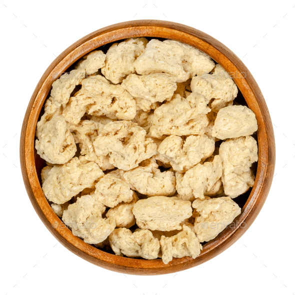 Soya chunks, textured soy protein, soy meat in wooden bowl - Stock Photo - Images