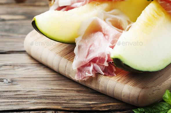 Fresh melon and spanish hamon - Stock Photo - Images