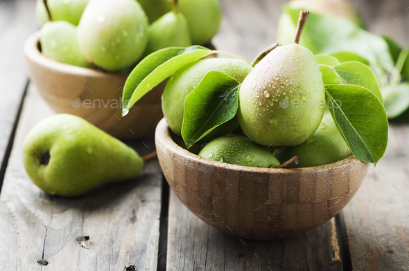 Sweet green pears on the wooden table - Stock Photo - Images