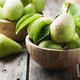 Sweet green pears on the wooden table - PhotoDune Item for Sale