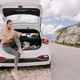 smiling woman travel by car in mountains - PhotoDune Item for Sale
