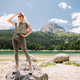 attractive woman relax in mountains with lake view - PhotoDune Item for Sale