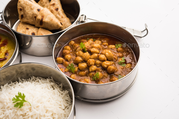Indian Veg Lunchbox for office of workplace with chole, dal fry rice and chapati - Stock Photo - Images