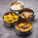 Indian Lunchbox or Tiffin includes Cauliflower Masala, Dal Fry, Rice, Chapati and salad - PhotoDune Item for Sale