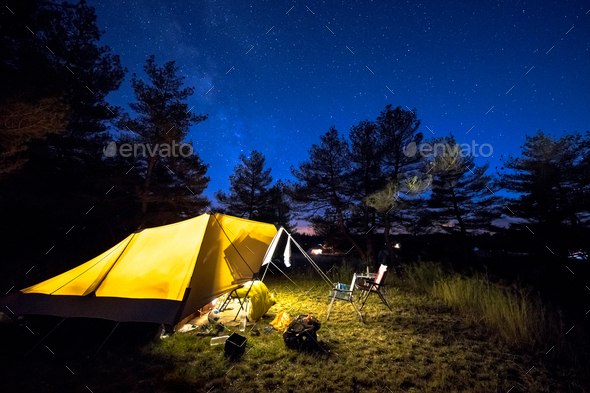 Family tent on camping ground under stars - Stock Photo - Images