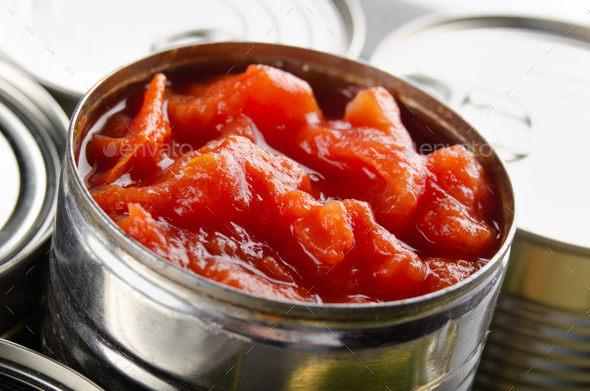 Canned sliced tomatoes in just opened tin can. Non-perishable food - Stock Photo - Images