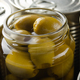 Canned green olives in just opened glass mason jar. Non-perishable food - PhotoDune Item for Sale