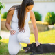 Smiling pregnant woman with a big belly pats her dog in the garden - PhotoDune Item for Sale