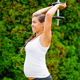 Pregnant Woman Performing Triceps Extension Exercise In Park - PhotoDune Item for Sale