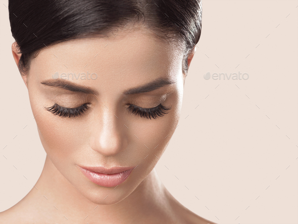 Beautiful woman healthy skin care concept portrait close up beige background. Studio shot - Stock Photo - Images