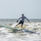 Middle aged man surfing on a long board in the Atlantic Ocean. - PhotoDune Item for Sale