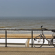 Parked bicycle on a fence near the sea - PhotoDune Item for Sale